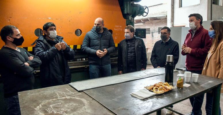 Molina, Campbell, Finocchiaro, Besana y Mac Goey en la metalúrgica DMG Montajes.